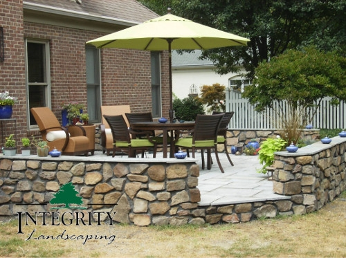 Natural Stone Patio with Stone Wall Surround